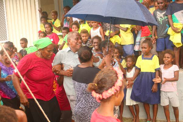 The former MPA Mr. Keith Amoasea is being pulled into the celeration dance by women and children
