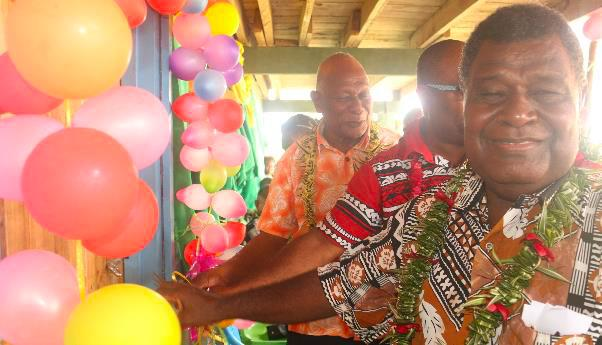 (L to R) Acting Premier for GP, Mr. Peter Aoraonisaka, PS MPGIS, Mr. Stanley Pirione, and Chairperson for Teatupa Primary School Board Mr. Batholomew Vavanga jointly cutting the ribbon to mark the opening of the opening of the classrooms